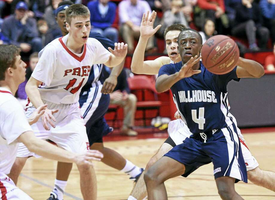 Hillhouse's Tyler Douglas looks to pass in the Academics' 44-40 victory over Fairfield Prep earlier this season. The two teams meet for the SCC tournament title Wednesday. Photo: Arnold Gold — New Haven Register