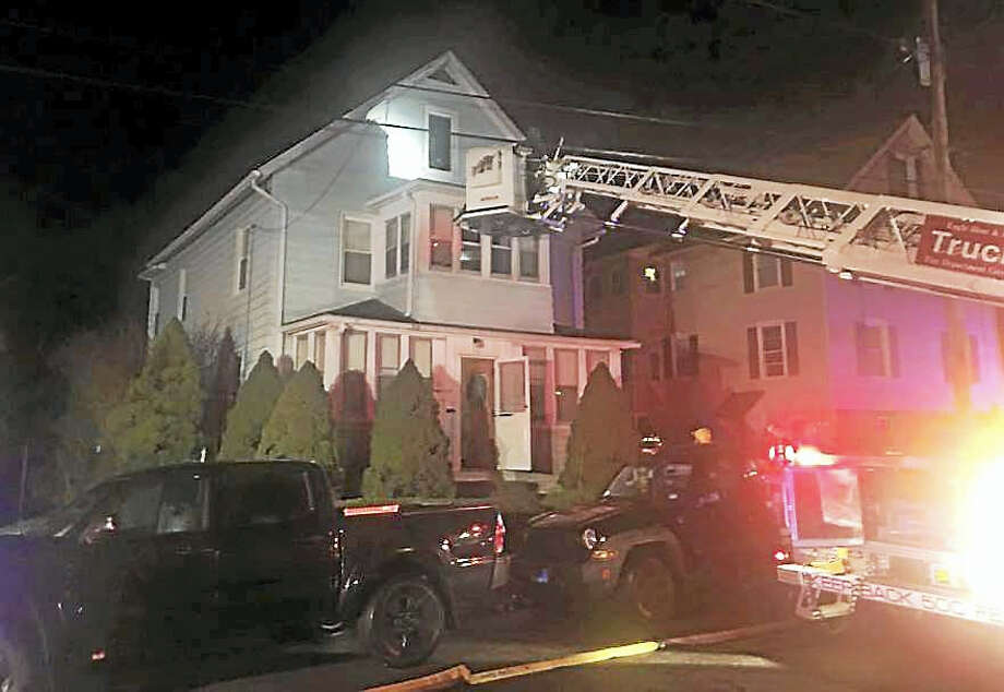 Firefighters from Ansonia and Derby worked together to put out a fire late Tuesday night at 15 Scotland St. in Ansonia. Photo: Courtesy Of Ansonia Fire Department