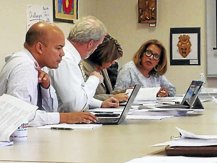Imma Canelli, second from right, at a Nov. 16 Board of Education committee meeting. Chief Financial Officer Victor de la Paz, Chief Operating Officer William Clark and board member Alicia Caraballo sit beside her. Canelli's last day with the district will be June 30. Photo: Brian Zahn — New Haven Register