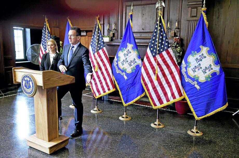 Gov. Dannel Malloy discusses affordable housing at a press conference at the West Village Apartments in New Haven Friday. In the background is state Department of Housing Commissioner Evonne Klein. Photo: Arnold Gold — New Haven Register