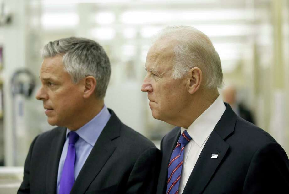 "Vice President Joe Biden walks with former Utah Gov. Jon M. Huntsman during a tour of the research lab at the Huntsman Cancer Institute Friday, Feb. 26, 2016, in Salt Lake City, as part of the White House's cancer ""moonshot,"" an ambitious effort to double the rate of progress toward curing cancer and ramp up federally funded research on the disease. Working toward a cure for cancer is personal for Biden, whose 46-year-old son, former Delaware state Attorney General Beau Biden, died from brain cancer in May. Photo: AP Photo/Rick Bowmer, Pool    / POOL AP"
