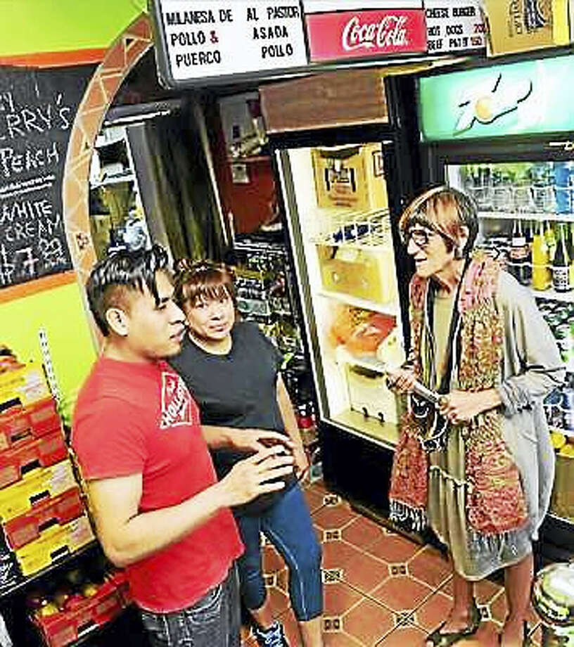In this recent file photo, U.S. Rosa DeLauro, D-3, right, chats with Miguel Xicohtencatl, left, and his wife Cecilia Serrano, center, at his ice cream store, El Xicohtencatl S.A. Grocery, LLC, on Grand Avenue in New Haven, during a tour of Latino-owned businesses. Photo: Peter Hvizdak - New Haven Register
