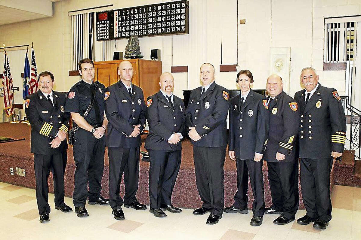 From left, East Haven Fire Chief Douglas Jackson, Mathew Hall, Bryan Kollmer, Robert Black, Christopher Rosa, Fred Parlato, Batallion Chief James Oca and Assistant Chief Chuck Licata were honored for their efforts in a Jan. 6 fire