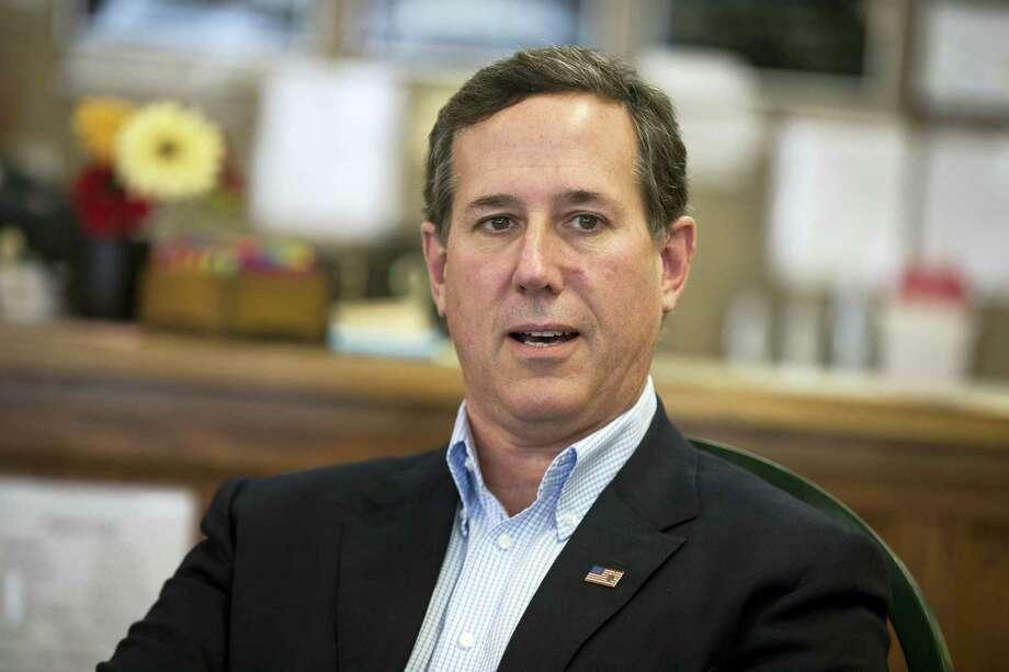 In this photo taken Jan. 19, 2016, former Pennsylvania Sen. Rick Santorum meets with voters in Greenfield, Iowa. Santorum said Wednesday, Feb. 3, 2016, that he is suspending his second bid for the White House. Photo: AP Photo/Evan Vucci / AP
