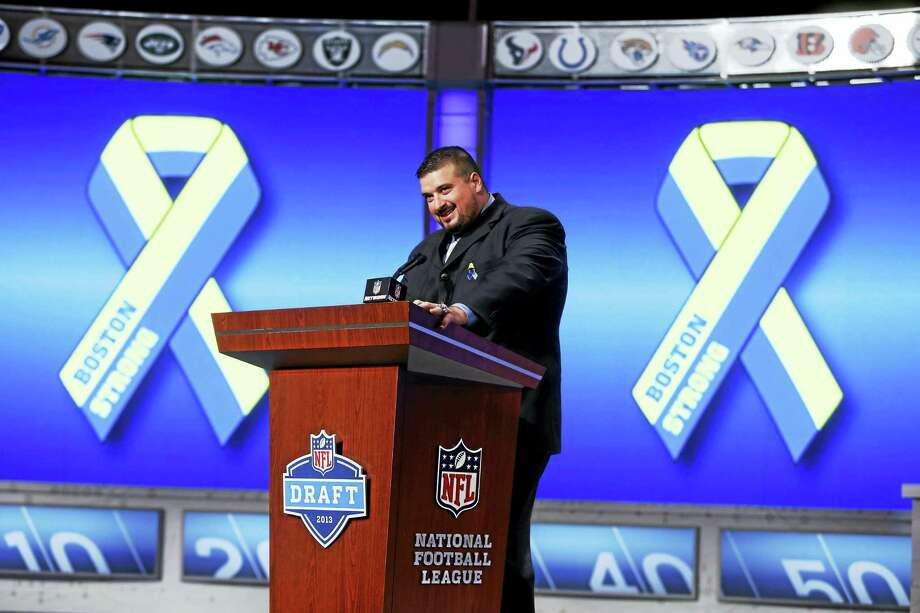 Former Southern Connecticut State All-American Joe Andruzzi has been named the 2016 Man of the Year by the Walter Camp Foundation. Photo: The Associated Press File Photo   / FR103966 AP