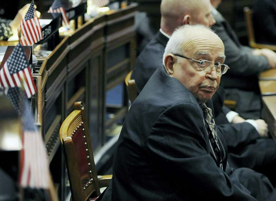 State Rep. Al Adinolfi, R-Cheshire, listens to Connecticut Gov. Dannel P. Malloy's budget address Wednesday in Hartford. Photo: Jessica Hill — The Associated Press   / FR125654 AP