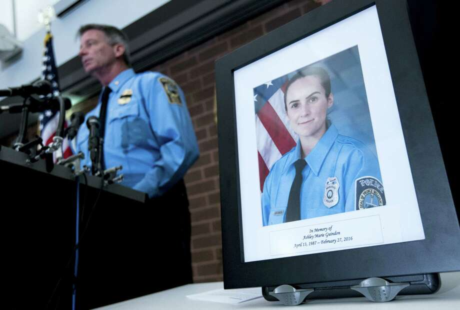 Prince William County Police Chief Stephan Hudson, left, speaks during a news conference next to a picture of Ashley Guindon at Western District Station, in Manassas, Va., Feb. 28. Photo: Jose Luis Magana — The Associated Press   / FR159526 AP