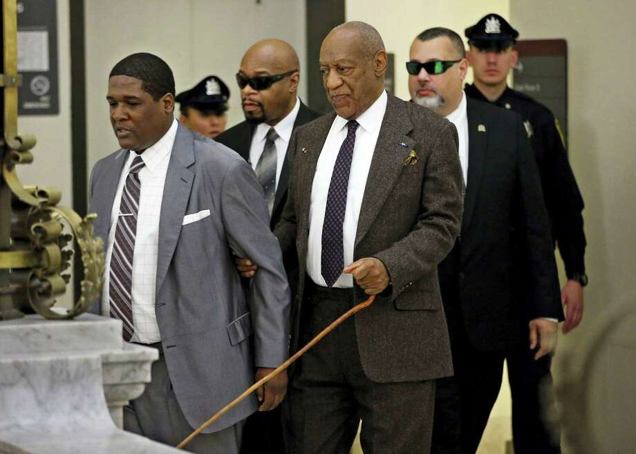 Holding onto his security team, Bill Cosby uses a cane as he returns to Courtroom A after a lunch break on Wednesday, Feb. 3, 2016, in the Montgomery County Courthouse in Norristown, Pa. The prosecutor in the sexual assault case against Cosby argued Wednesday that his predecessor had no legal authority to make a deal a decade ago that would shield the comedian from ever facing charges. Photo: Michael Bryant/The Philadelphia Inquirer Via AP, Pool / Pool Philadelphia Inquirer