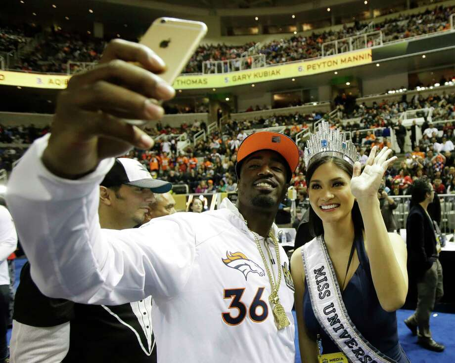 Miss Universe Pia Alonzo Wurtzbach poses with Denver Broncos cornerback Kayvon Webster during Opening Night for Super Bowl 50 Monday in San Jose, Calif. Photo: Marcio Jose Sanchez — The Associated Press   / AP