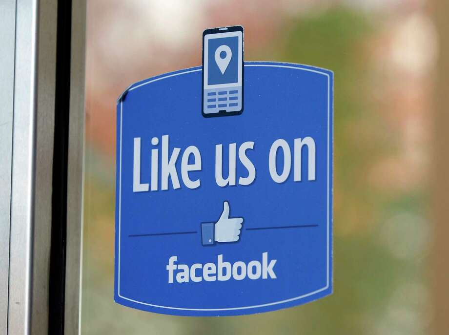 """AP Photo/Paul Sakuma, File  A sign with Facebook's """"Like"""" logo is posted at Facebook headquarters near the office for the company's User Operations Safety Team in Menlo Park, Calif. Photo: AP / AP"""