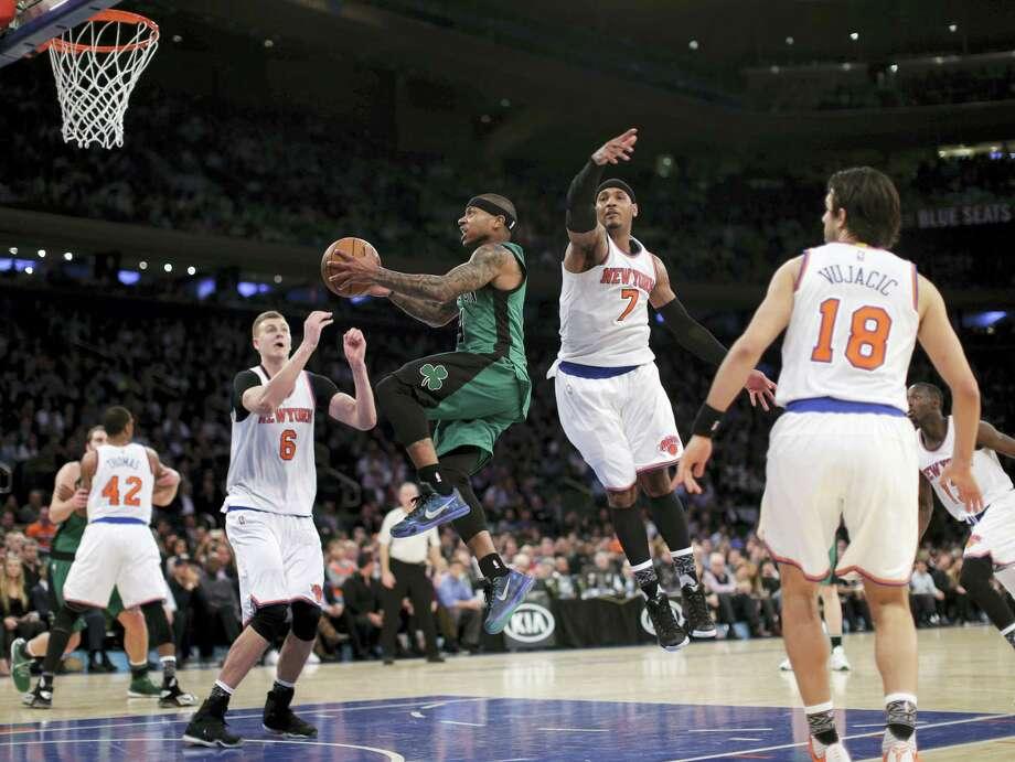 Celtics guard Isaiah Thomas drives through the Knicks defense during the third quarter Tuesday in New York. The Celtics won 97-89. Photo: Julie Jacobson — The Associated Press   / AP