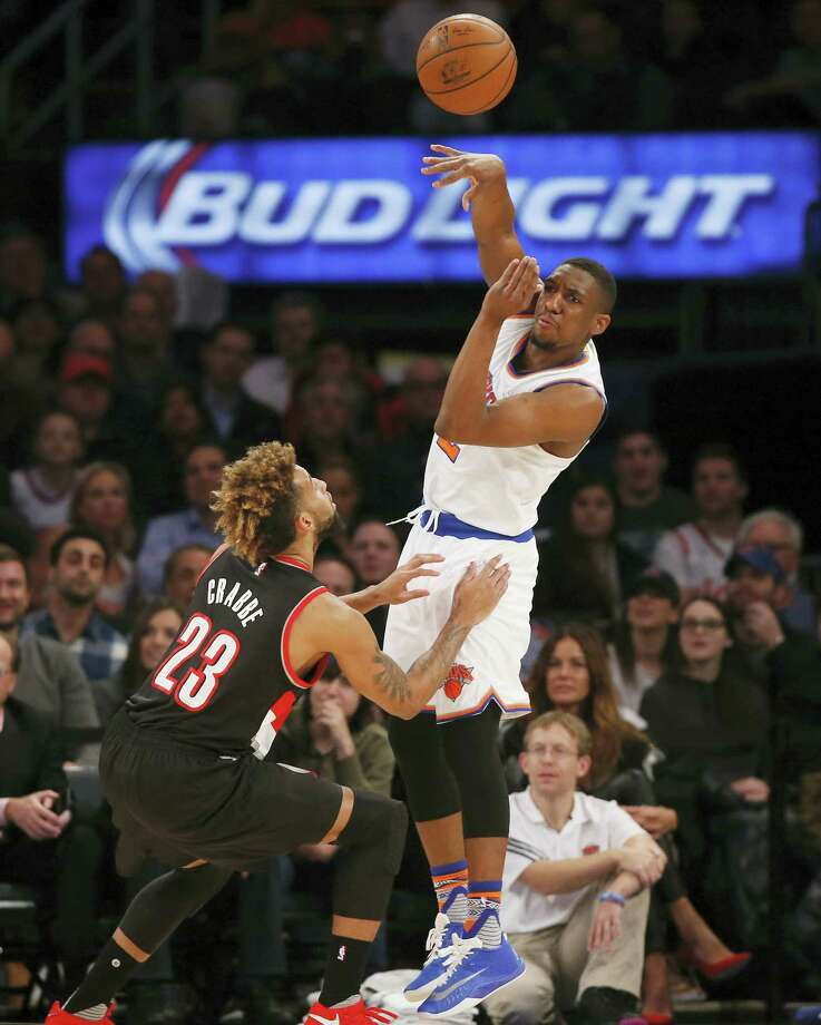 Knicks guard Langston Galloway (2) passes over Blazers guard Allen Crabbe in the first half in New York on Tuesday. Photo: Kathy Willens — The Associated Press   / Copyright 2016 The Associated Press. All rights reserved. This material may not be published, broadcast, rewritten or redistributed without permission.