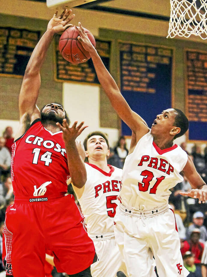 Fairfield Prep's Senay Bellete (31) and Matt Gerics (5) block the shot by Wilbur Cross's Robert Durant Jr.'s layup try during the Jesuits 80-61 win Monday night in East Haven. Photo: John Vanacore — The New Haven Register   / John Vanacore-Register