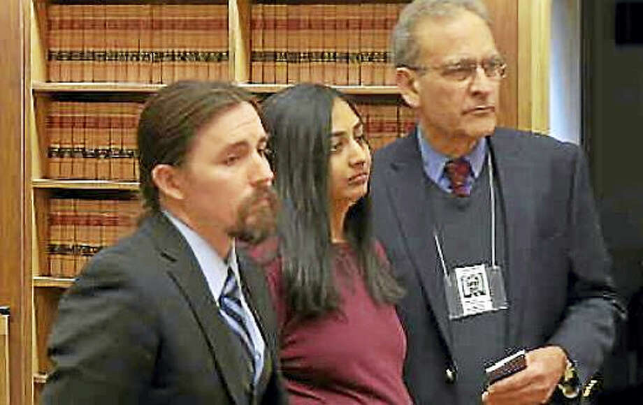 SCREENSHOT OF VIDEO COURTESY OF WFSB  Kinjal Patel, center, during her sentencing Tuesday. Photo: Journal Register Co.