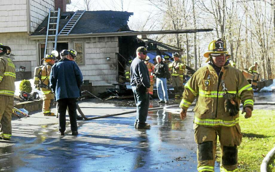 Firefighters from North Branford and Guilford battled a garage fire Tuesday at 404 Sea Hill Road. Photo: Wes Duplantier — New Haven Register