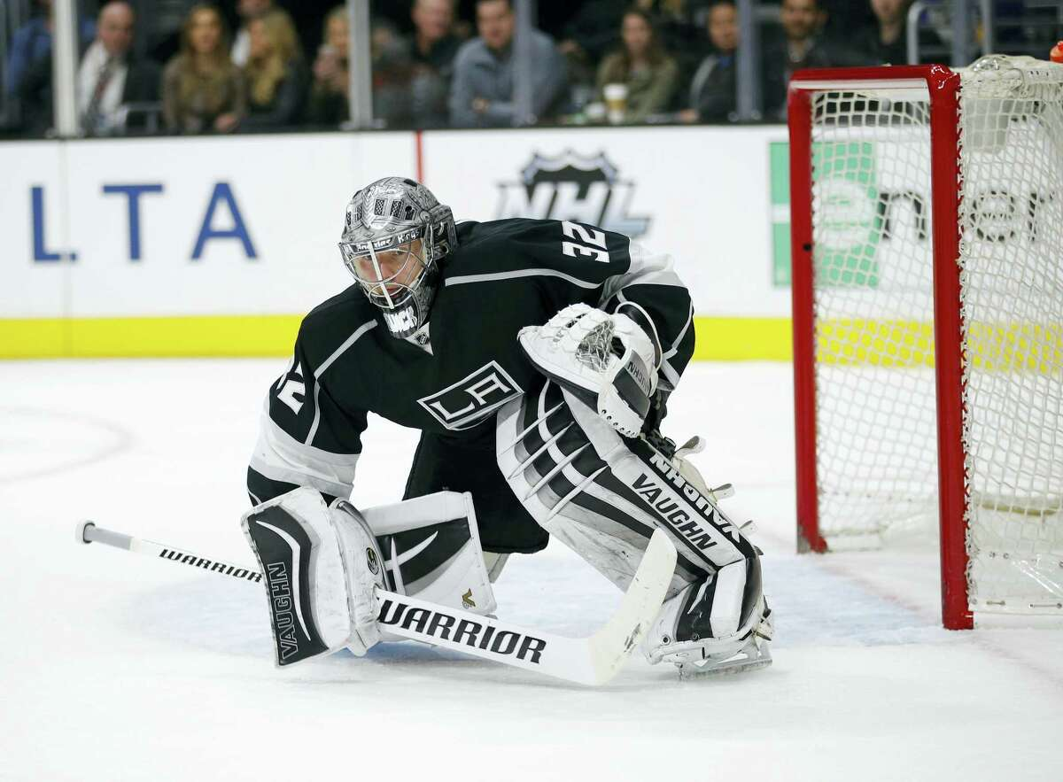 Los Angeles Kings goalie Jonathan Quick kneels in front of the net during the third period of an NHL hockey game against the Philadelphia Flyers, Saturday, Jan. 2, 2016, in Los Angeles. (AP Photo/Jae C. Hong)