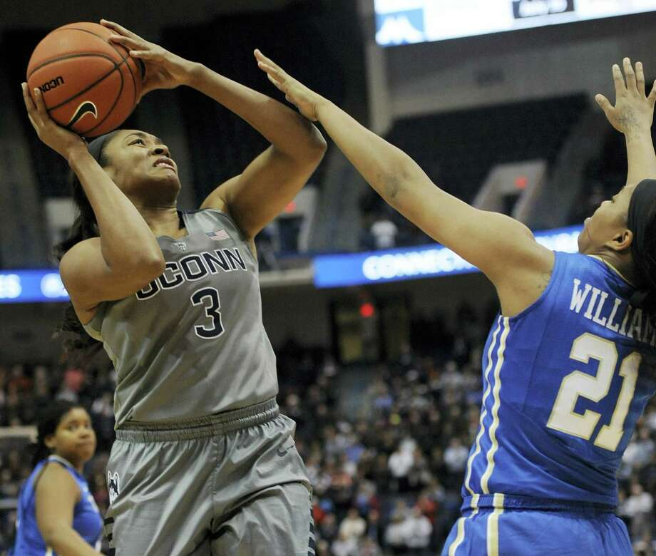 Connecticut's Morgan Tuck, left, is fouled by Tulsa's Te'era Williams in the first half of an NCAA college basketball game, Wednesday, Jan. 6, 2016, in Hartford, Conn. (AP Photo/Jessica Hill) Photo: AP / FR125654 AP
