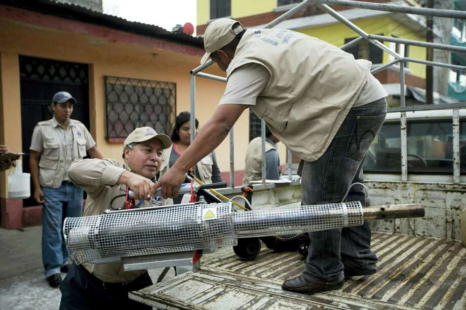 A Health Ministry brigade arrives to the Bethania neighborhood to fumigate for Aedes aegypti mosquitoes in Guatemala City, Tuesday, Feb. 2, 2016. The Aedes aegypti mosquito is vector for the spread of the Zika virus which has suspected links to birth defects in newborn children. There is no treatment or vaccine for the mosquito-borne virus, which is in the same family of viruses as dengue. Photo: AP Photo/Moises Castillo / AP