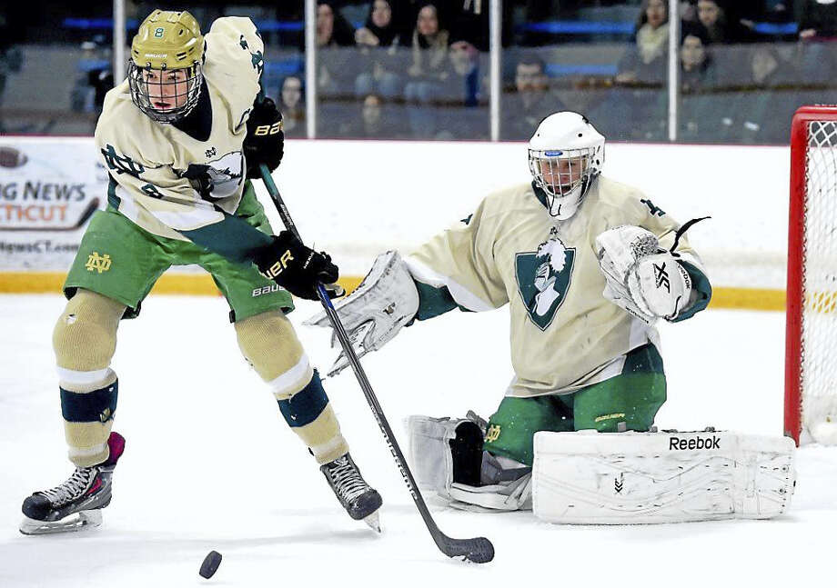 Padraic Connors (left) and goalie Conor Hylton of Notre Dame-West Haven defend against Xavier in the West Haven High School Hockey Christmas Tournament earlier this week. Photo: Photo By Arnold Gold — New Haven Register