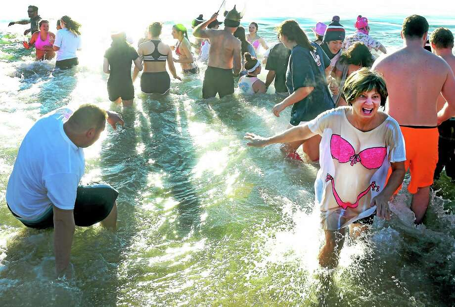 Participants run into the frigid water during West Haven's 15th Annual Icy Plunge for the Cur fundraiser which benefits breast cancer research, at the Savin Rock Conference Center in West Haven Saturday morning,  January 16, 2015. Photo: PETER HVIZDAK — NEW HAVEN REGISTER   / ©2015 Peter Hvizdak