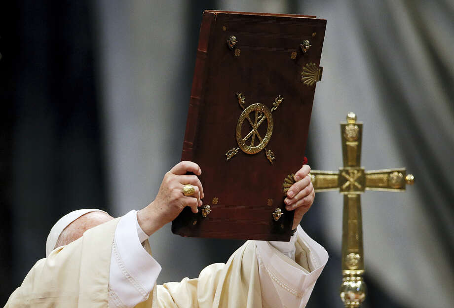 Pope Francis holds the book of the gospel as he celebrates a Mass in St. Peter's Basilica, at the Vatican, to mark Epiphany, Wednesday, Jan. 6, 2016. The Epiphany is a joyous day for Catholics in which they recall the journey of the Three Kings, or Magi, to pay homage to Baby Jesus. Photo: AP Photo/Gregorio Borgia    / AP