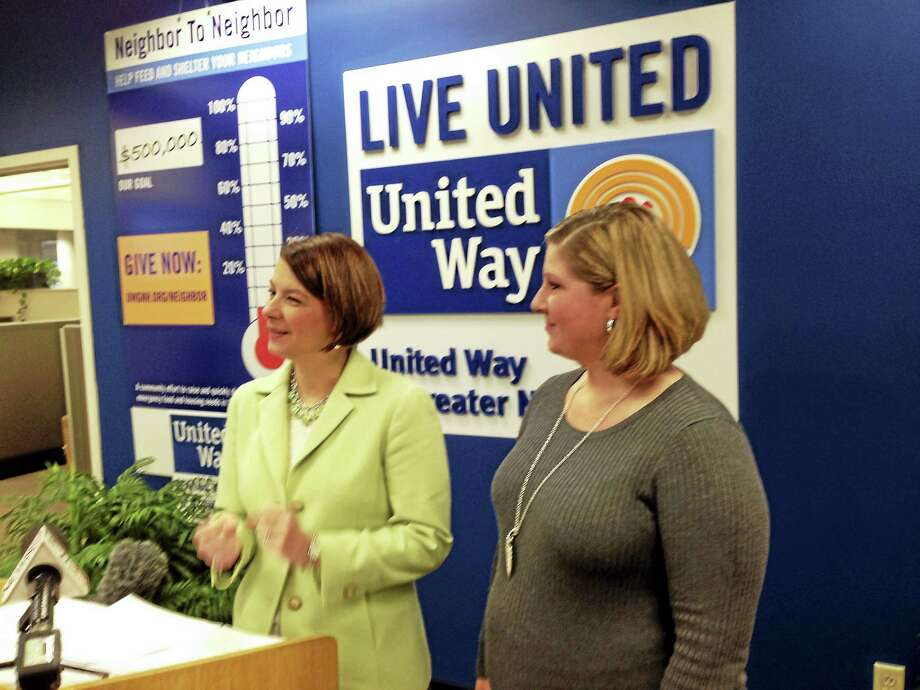 Sada Marshall, right, and Jennifer Heath of United Way of Greater New Haven, kick off the agency's Neighbor to Neighbor campaign Tuesday. Photo: ED STANNARD — NEW HAVEN REGISTER