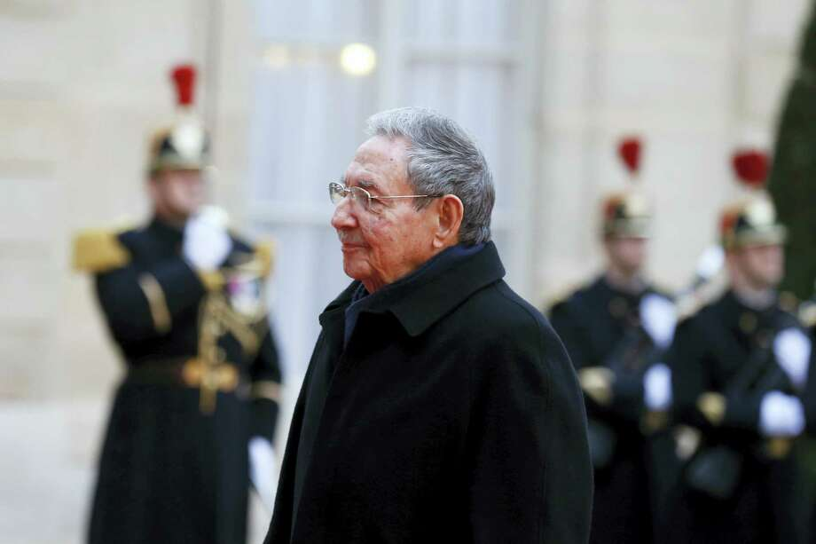 Cuban President Raul Castro reviews the French Republican Guards of Honor upon his arrival for a meeting with French president Francois Hollande at the Elysee Palace, in Paris, France, Monday. Photo: Francois Mori — The Associated Press   / AP