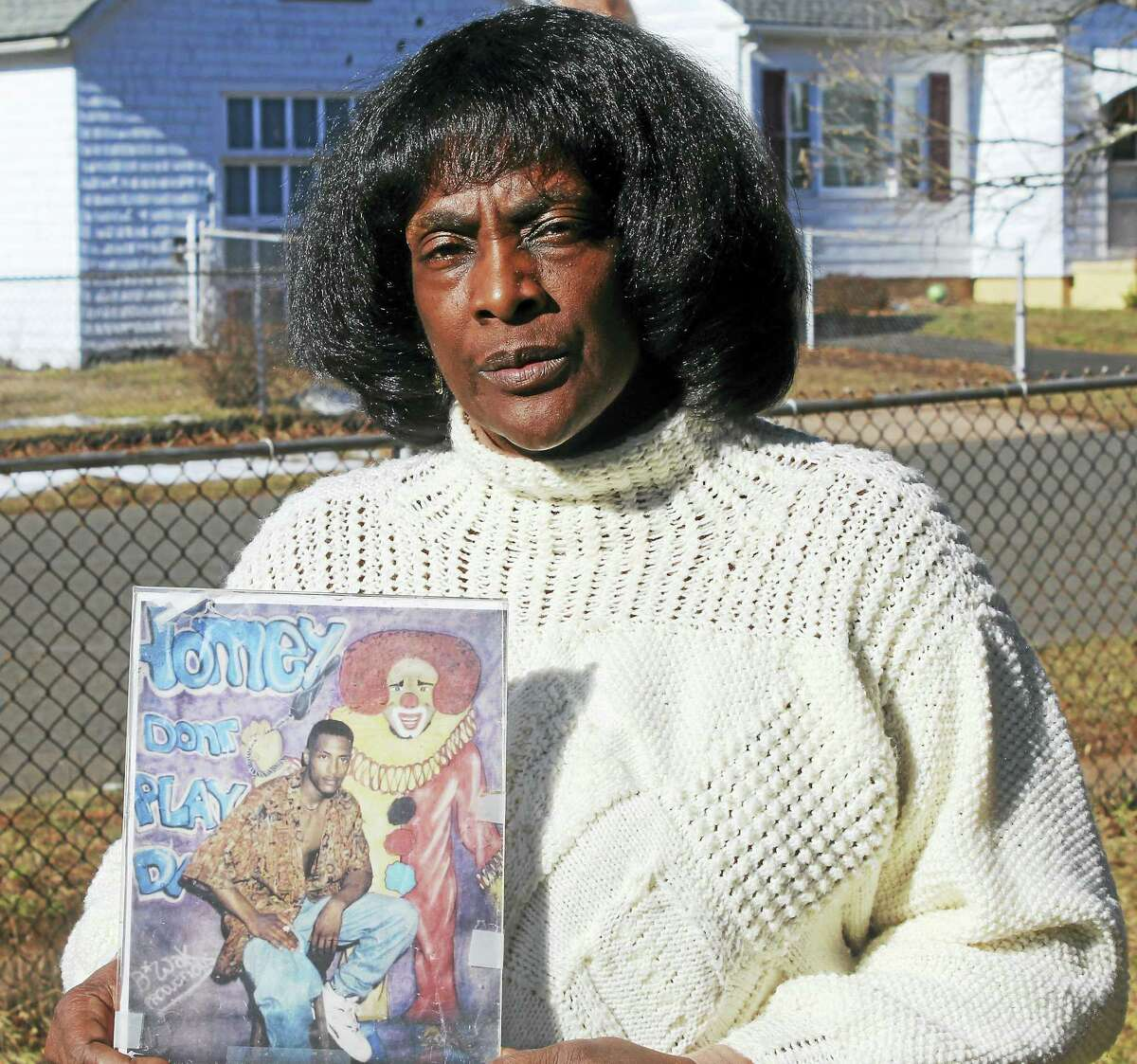 Robin Smith holds a picture of her son, Jason, who was killed in a 1996 shooting in New Haven.
