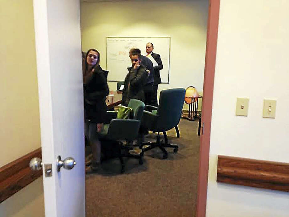 Members of the Board of Education scheduled a public meeting, but met privately before starting its meeting, without a quorum. Photo: Brian Zahn — New Haven Register