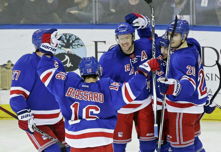 New York Rangers' Ryan McDonagh (27), Derick Brassard (16), Chris Kreider (20) and Chris Kreider (20) celebrate with Mats Zuccarello after Zuccarello scored a goal against the Buffalo Sabres last week. The Rangers are in second place in the Metropolitan Division, but 14 points behind the Capitals. Photo: The Associated Press   / AP