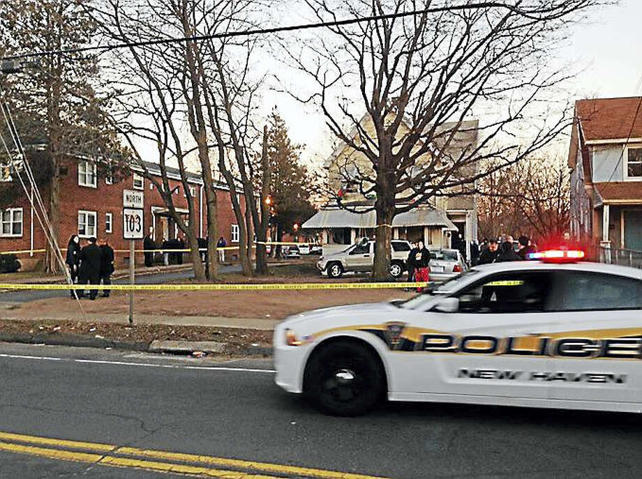 Police investigate a shooting Wednesday on Quinnipiac Avenue in New Haven. Photo: Ryan Flynn — New Haven Register