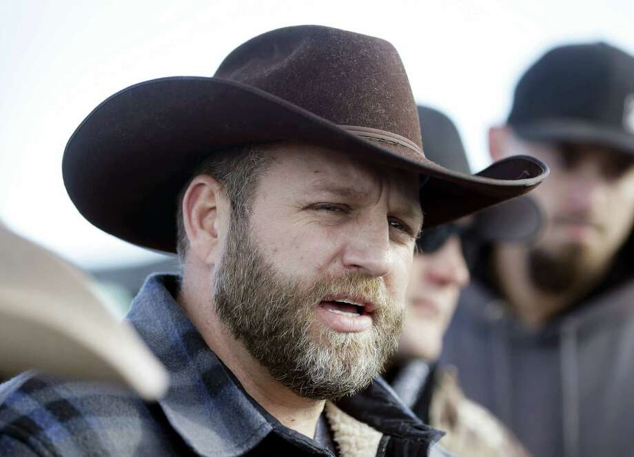 Ammon Bundy, one of the sons of Nevada rancher Cliven Bundy, speaks to reporters during a news conference at Malheur National Wildlife Refuge on Wednesday, Jan. 6, 2016, near Burns, Ore. With the takeover entering its fourth day Wednesday, authorities had not removed the group of roughly 20 people from the Malheur National Wildlife Refuge in eastern Oregon's high desert country. Photo: AP Photo/Rick Bowmer / AP