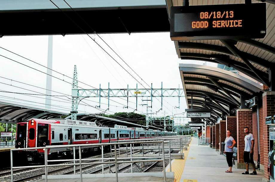 MELANIE STENGEL — NEW HAVEN REGISTER FILE PHOTO   A train from New York arrives at the West Haven Train Station, while people wait for another train going into New York. Photo: Journal Register Co.