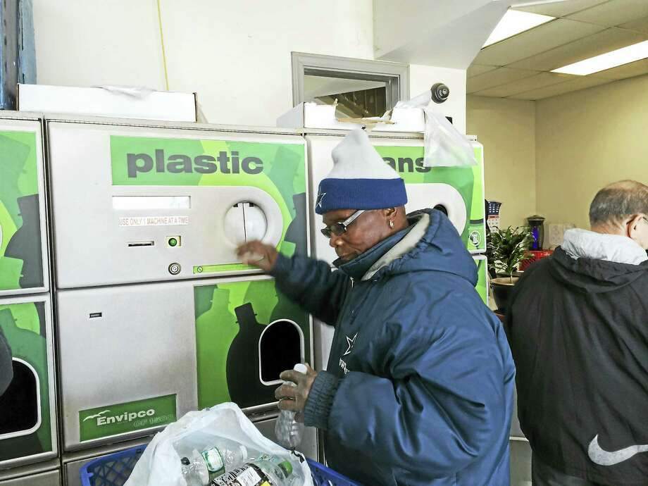 Abraham Robinson of Meriden recycles bottles Tuesday at the M&M Redemption Center in Wallingford. Photo: LUTHER TURMELLE — NEW HAVEN REGISTER