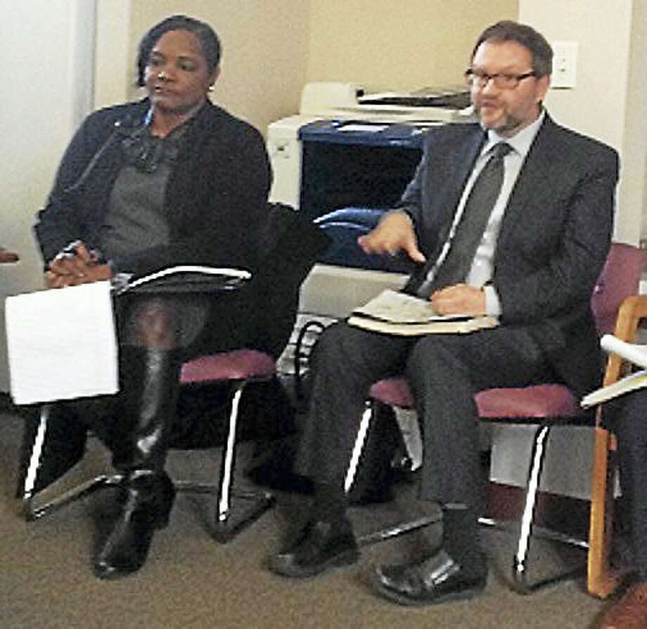 From left, Serena Neal-Sanjurjo, head of Livable City Initiative, and Michael Lozano of Community Builders listen to Dwight neighborhood residents. Photo: Mary O'Leary — New Haven Register