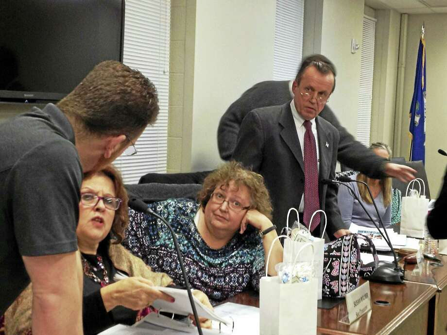 West Haven Board of Education members confer after voting down and then tabling Superintendent Neil Cavallaro's proposed budget Monday. Photo: MARK ZARETSKY — NEW HAVEN REGISTER