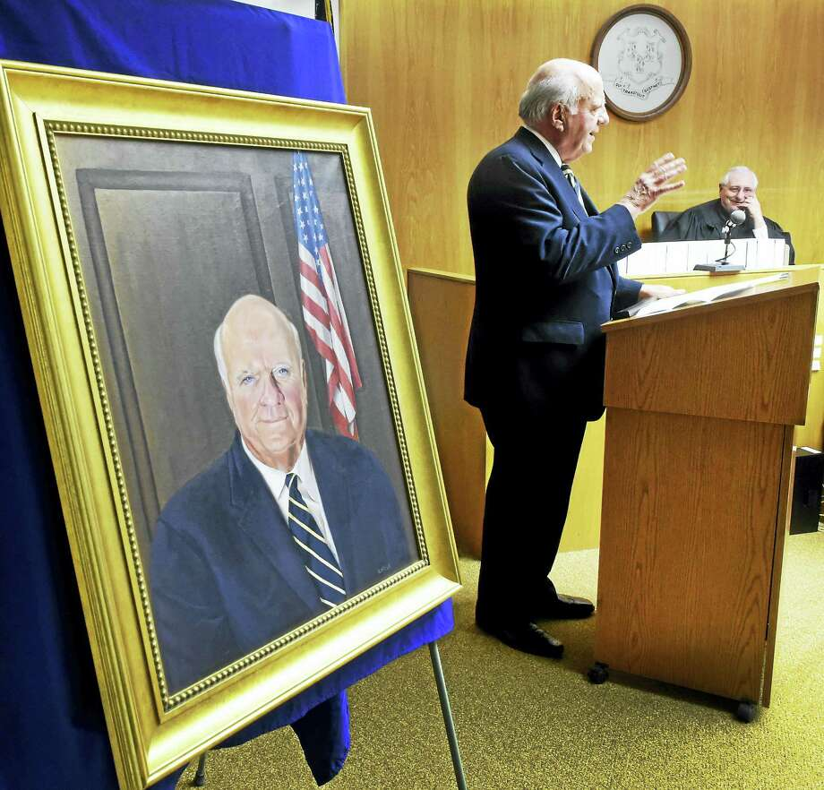 (Peter Hvizdak - New Haven Register) Judge Joseph P. Flynn, retired Chief Judge of the Appellate Court, Judge of the Appellate Court and Superior Court Judge, addresses well-wishers after the unveiling of his portrait at the Derby Superior Court house in Derby Tuesday, January 5, 2016. Administrative Judge Frank A. Iannotti, right,  presided over the event. The portrait was commissioned in recognition of Flynn's record of distinguished service as a jurist by the Lower Naugatuck Valley Bar Association. Photo: Peter Hvizdak — New Haven Register / ©2016 Peter Hvizdak