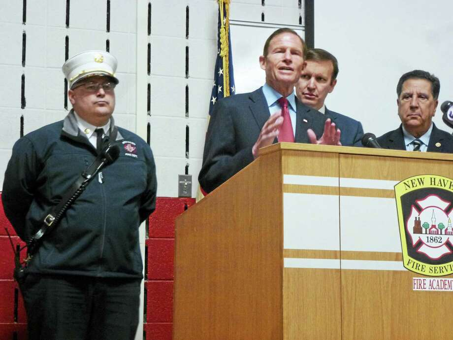 Joined by acting Chief Matthew Marcarelli, U.S. Sen. Chris Murphy and Peter Carozza, president of the Uniformed Professional Fire Fighters of Connecticut, U.S. Sen. Richard Blumenthal discusses the extension of 9/11 benefits. Photo: Ryan Flynn — New Haven Register
