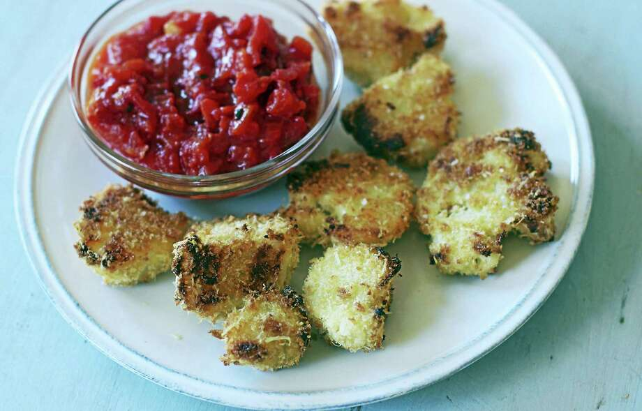 Breaded Cauliflower Cutlets With Marinara Sauce Photo: Matthew Mead - Associated Press   / FR170582 AP