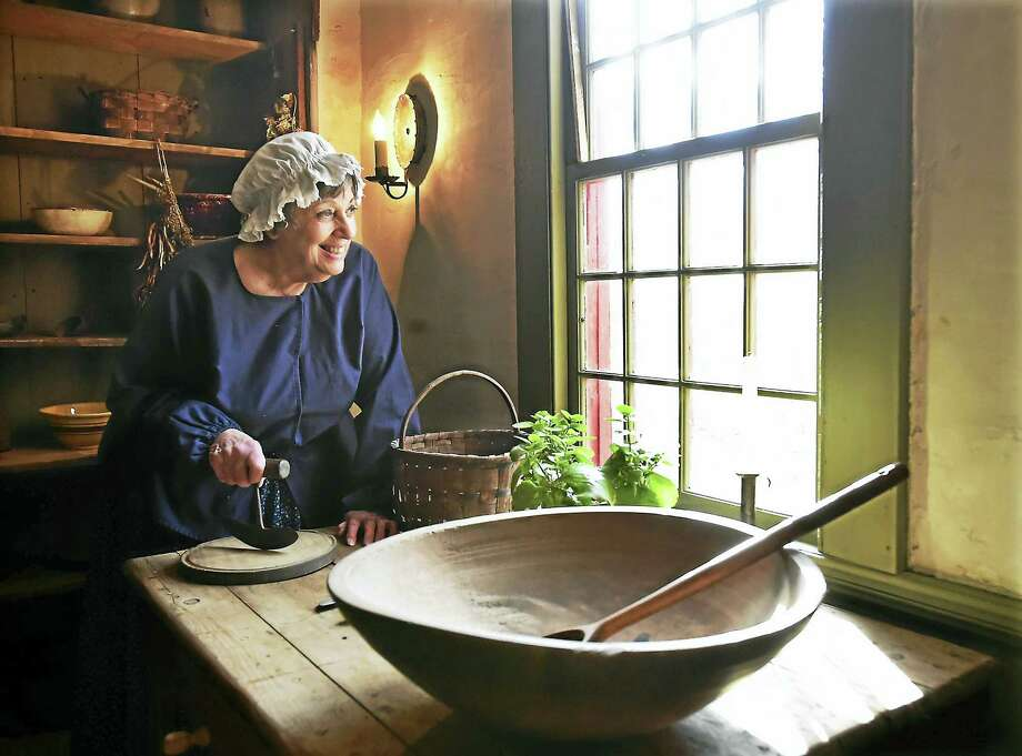 Ginny Reinhard, the president of the Orange Historical Society, photographed Thursday in the buttery of the recently restored Bryan-Andrew House, a 1740 vernacular cape on Old Tavern Road in Orange. Photo: Photos By Catherine Avalone — New Haven Register   / Catherine Avalone/New Haven Register