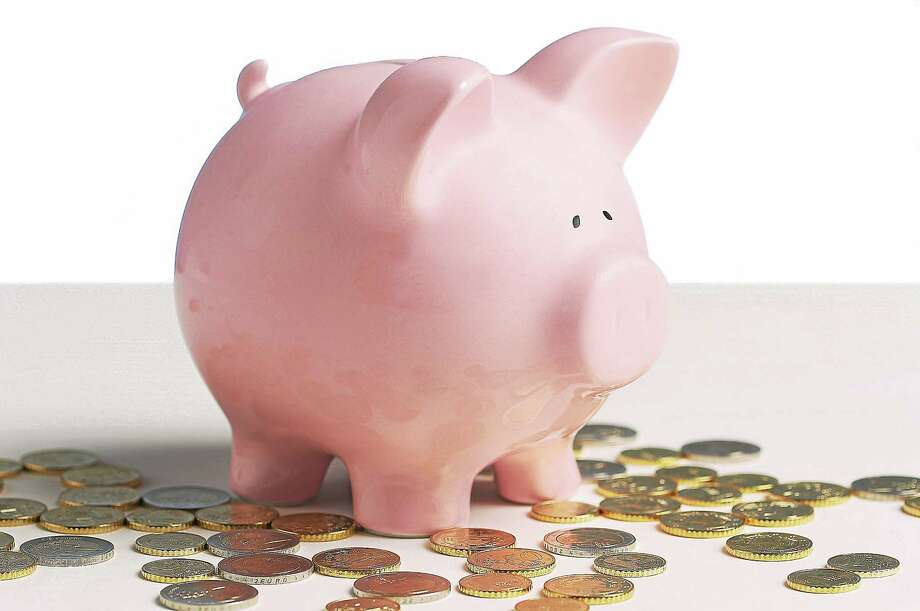 Piggy bank and coins Photo: Getty Images / (c) Hemera Technologies