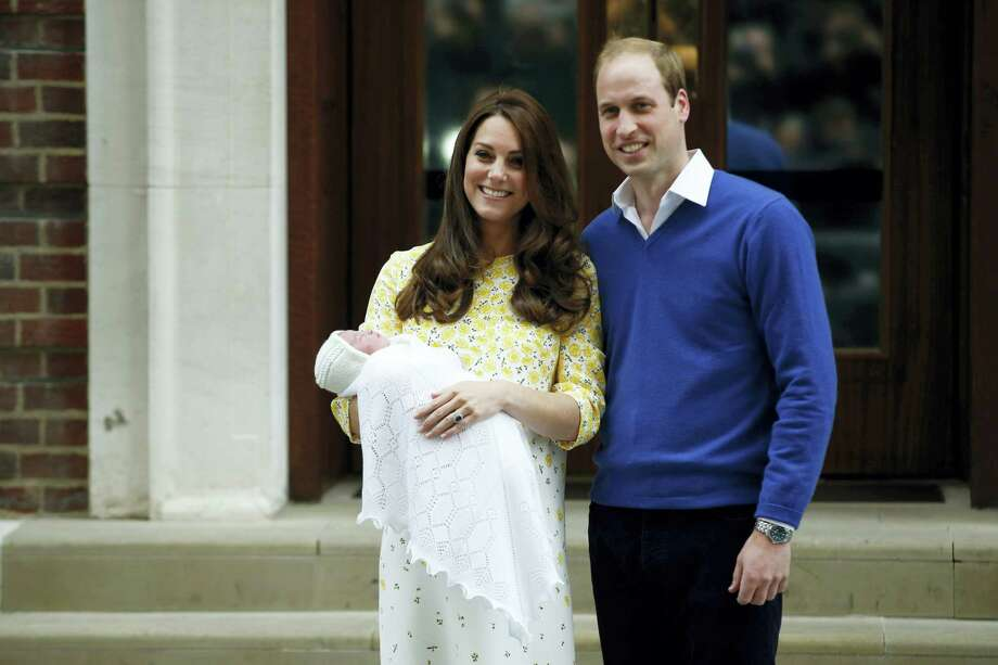 Britain's Prince William, right, and Kate, Duchess of Cambridge, hold their newborn daughter as they pose for the media outside the St. Mary's Hospital's exclusive Lindo Wing, London on May 2, 2015. Photo: AP Photo/Alastair Grant   / AP