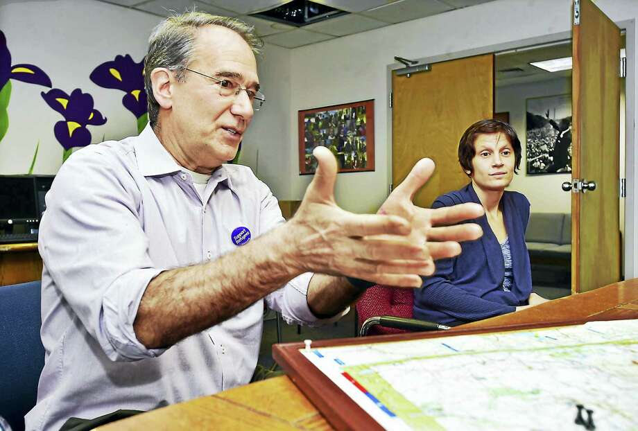 (Catherine Avalone - New Haven Register)   Chris George, the executive director of IRIS, and Ashley Makar, outreach coordinator talk about the Jewish Federation's commitment to help resettle  refugees. Photo: Journal Register Co. / New Haven RegisterThe Middletown Press