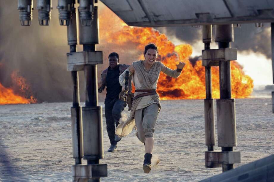 "This photo provided by Disney/Lucasfilm shows Daisy Ridley, right, as Rey, and John Boyega as Finn, in a scene from the film, ""Star Wars: The Force Awakens,"" directed by J.J. Abrams. Photo: David James/Disney/Lucasfilm Via AP   / Disney/Lucasfilm"