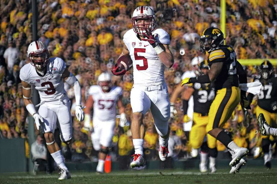 Stanford running back Christian McCaffrey scores against Iowa during the Rose Bowl on Friday in Pasadena, Calif. Photo: Mark J. Terrill — The Associated Press   / AP