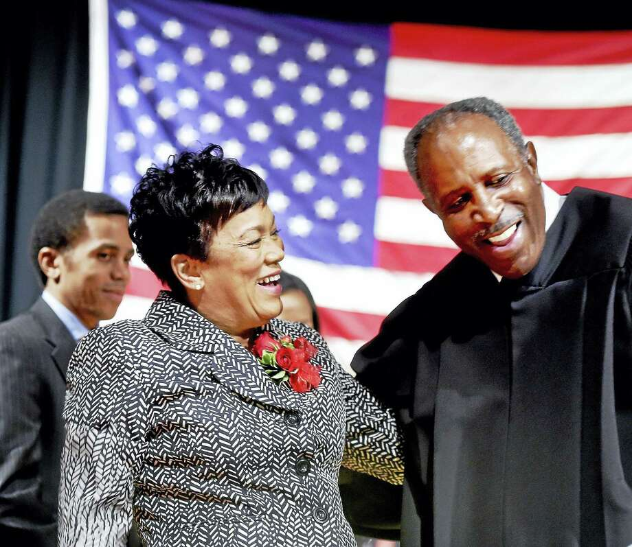 (Arnold Gold-New Haven Register)  New Haven Mayor Toni Harp (left) and retired Connecticut Supreme Court Justice Lubbie Harper, Jr., share a laugh after Harper administered the oath of office to Harp at Hill Regional Career High School on 1/1/2016. Photo: Journal Register Co.