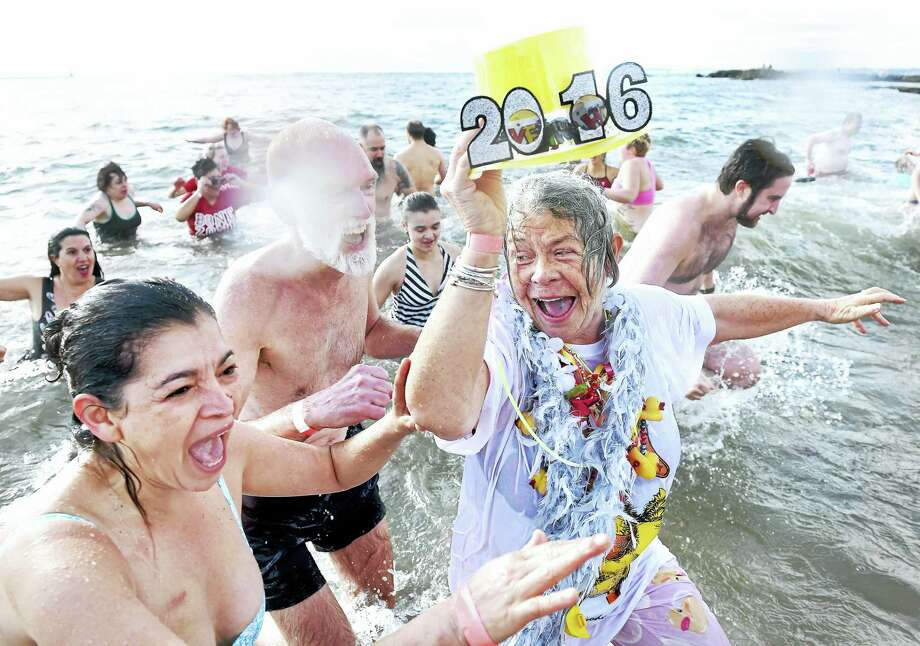 (Arnold Gold-New Haven Register)  Left to right, Rosa Rayas of Wallingford, Brad Duckrow of New Haven and his wife, Liz, celebrate First Day New Haven with a polar plunge into the Long Island Sound at Lighthouse Point Park in New Haven on 1/1/2016. Photo: Journal Register Co.