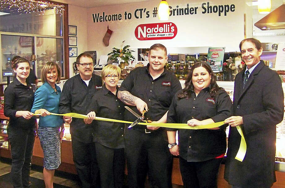 THE DAILY GRIND(ER): A grand opening was held Dec. 9 for Nardelli's Grinder Shoppe, 970 F N. Colony Road, Wallingford. The restaurant offers eat-in or take-out lunches, dinner and catering menus, according to a release. Business hours are 9 a.m. to 9 p.m. Monday through Saturday. Celebrating the opening were, from left, Tiffanie Logan, general manager; Dee Prior-Nesti, executive director, Quinnipiac Chamber of Commerce; Ronald Moro, owner; Nicole Moro, owner; Ernest Fanton, owner; Jen Morro Fanton, owner; and Mayor William Dickinson. Photo: CONTRIBUTED PHOTO