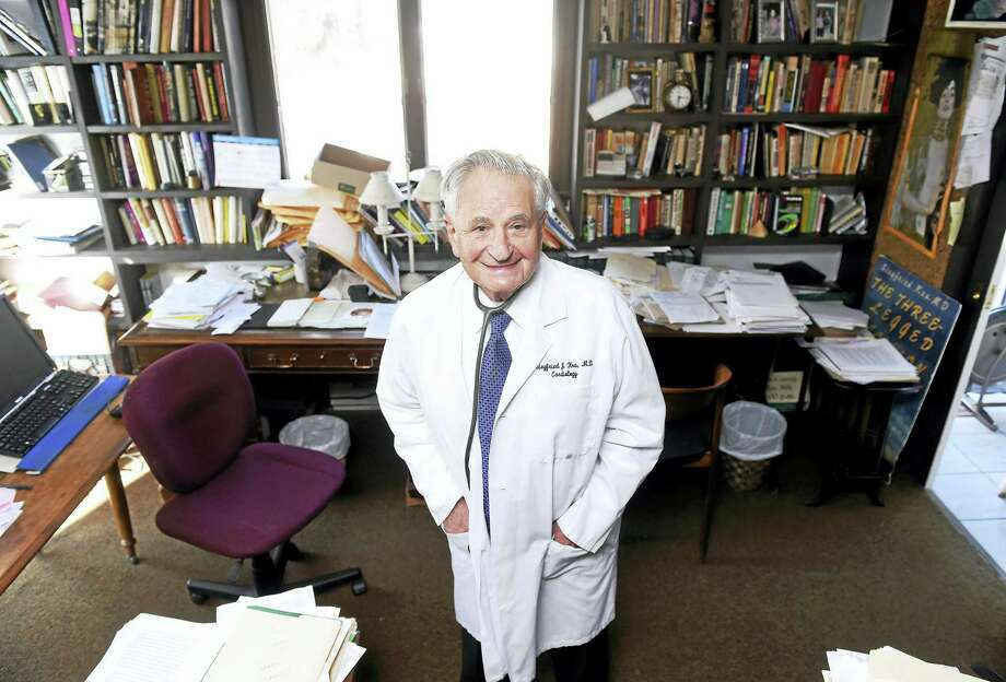 Dr. Siegfried Kra is photographed in the study of his home in Woodbridge on Dec. 17, 2014. Photo: Arnold Gold — New Haven Register File Photo