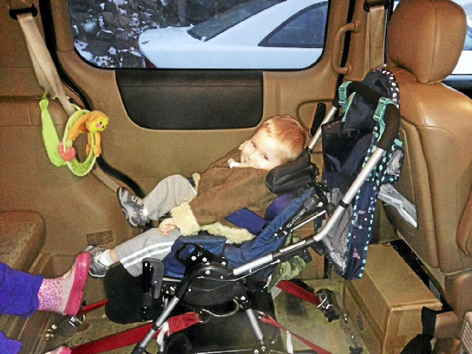 Nolan seated in the van that was donated to his family. Photo: Contributed Photo
